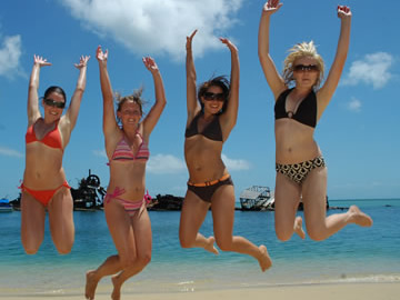 Girls enjoying Moreton Bay Beach with Supercat Charters
